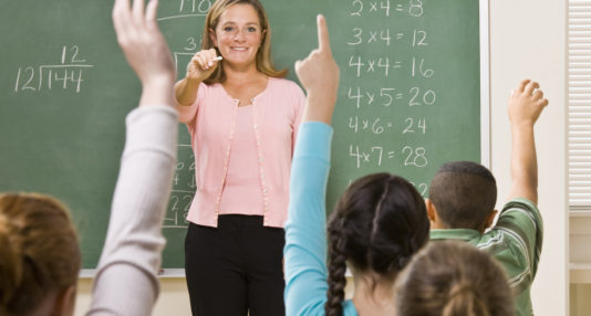 A substitute teacher manages a class of students