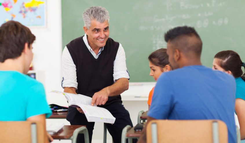 A short-term substitute teacher with students